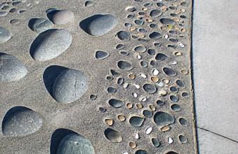 Decorative concrete Mukilteo North Platform - Site concrete, ADA ramps, hand seeded aggregates, embedded river rock, by Belarde Company  - Seattle, Washington
